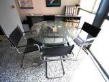 Mesa de reuniones de cristal redonda